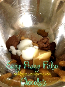 Coconut oil; peanut butter; honey; cocoa and vanilla in heated metal bowl to make healthy paleo chocolate