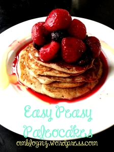 Paleo pancakes with berries and honey