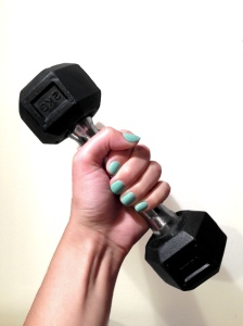 2kg dumbbell woman with mint nails